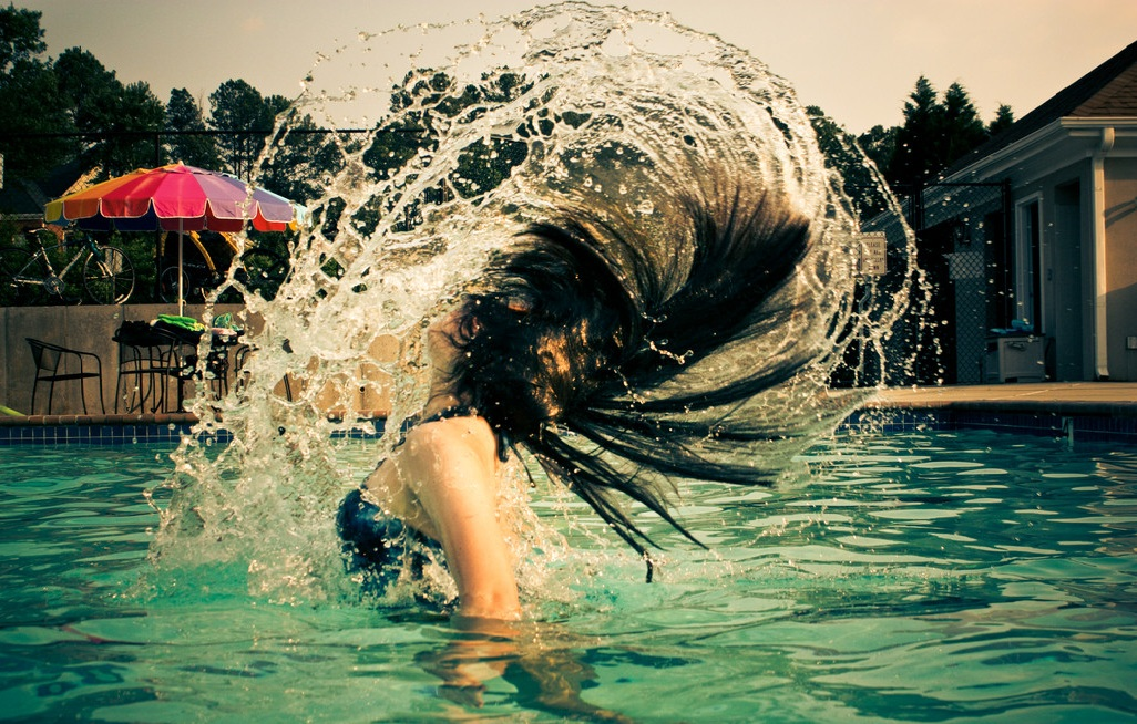 4 Ways To Protect Your Hair Against The Chlorinated Pool Water