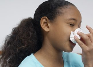 dangers of holding back sneeze