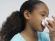 dangers of holding back sneeze
